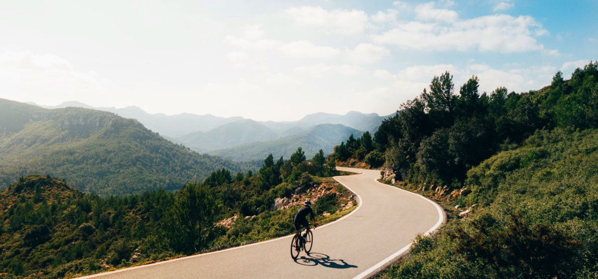 solitary biker on his cycling holiday in Spain and on the Costa Blanca