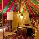 View of the sleeping area and bathroomwall of our luxurious rental tent La Jaima