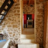 passage from the lounge to the well equipped kitchen of La Ruina
